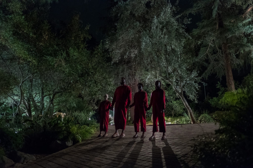 The Wilson family doppelgängers (from left), Pluto (Evan Alex), Abraham (Winston Duke), Umbrae (Shahadi Wright Jospeh) and Red (Lupita Nyong'o) in Us, written, produced and directed by Jordan Peele.